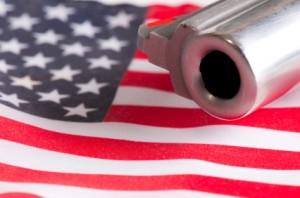 handgun on american flag