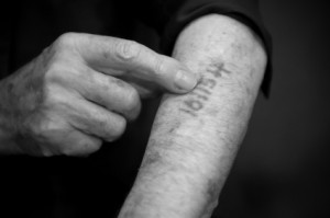 man showing auschwitz number on arm