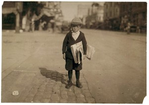 A 6-year-old newsie in Los Angeles, California. May 1915. Photograph by Lewis Wickes Hine